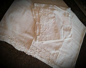 Vintage Pillowcases, matched pair, white cutwork embroidery