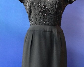 50's beaded cocktail dress with illusion neckline.