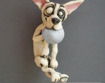 Dog Catching Frisbee Ceramic Wall Sculpture