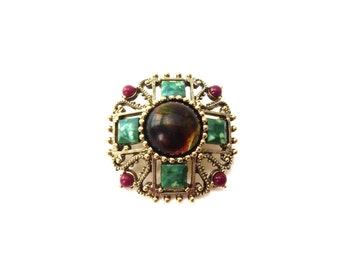 Vintage Unsigned 1928 Company Circular Shaped Gold Tone Metal Marbled Brown, Green & Red Plastic/Resin Cabochon Brooch