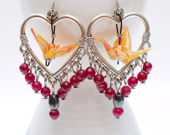 Origami crane earrings of orange paper in silver heart shaped hoop with garnet and hematite