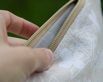 hydrangea in beige and grey, cotton and linen floral zip pouch