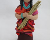 Women of the earth polymer clay sculpture figurine with reed bundle