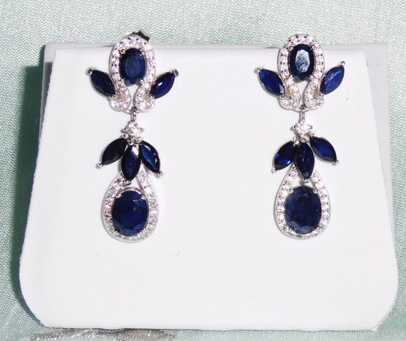 36 TCW Natural Deep Blue Sapphire gemstones, 14kt white gold post pierced earrings