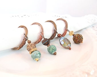 BEADED NAPKIN RINGS -  Guitar String Napkin Rings - set of 4 - gold, bronze, aquamarine-  upcycled/recycled - gifts under 25 dollars