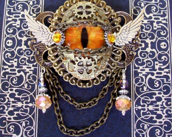 Dragon Eye Brooch (P604) - Tangerine Gold Glass Eye - Antique Brass Hardware - Crystal Dangles - Silver Wings - Pin Fastener with Bail Loops