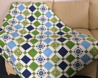 LAP QUILT in shades of blue, line green, and bright white