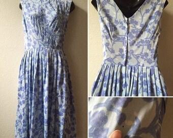 1950s floral dress, small 50s dress, v back dress, pleated skirt, blue floral dress, pin up girl dress, mad men dress, rockabilly dress,