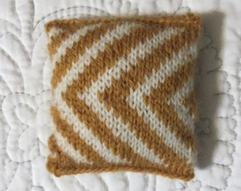 Knitted pincushion -- wool yarn, polyester fill -- goldenrod and white