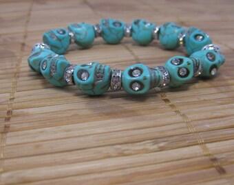 Rhinestone skull bracelet made with turquoise magnesite gemstone skulls and silver plated rhinestone spacers