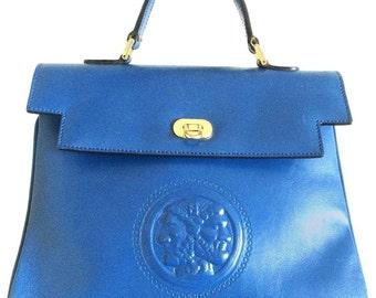 Vintage FENDI blue leather classic kelly style handbag with iconic Janus medallion embossed motif at front.