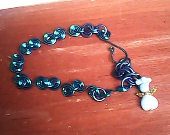 Handcrafted swirl link bracelet in blue. 7.5 - 8 inches with light blue angel.