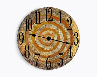 Speckled brown and tan wall clock with a whimsy rust colored swirl. Circle design.