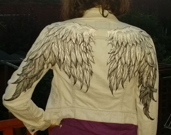 Angel Wings woman's denim jacket. Hand painted