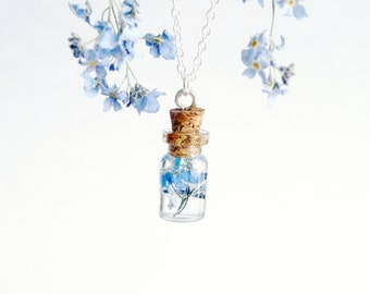 Tiny kawaii bottle forget me not necklace sterling silver forget me not jewelry blue bridesmaid necklace nature pressed flower charm resin