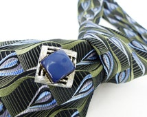 The Original Mag TAK. Vintage Upcycle: Mad Men mod textured silver with blue embellishment. Tie tack, hat pin or lapel pin all in one