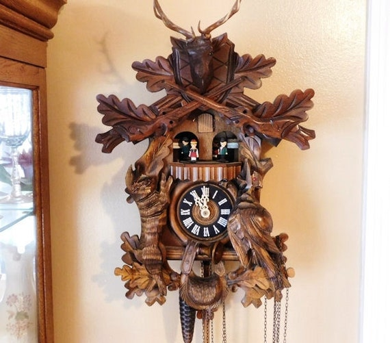 Black Forest Cuckoo Clock Vintage Deer Hunter Hunting Rifles Ammunition Bag Horn Animals Rabbit Pheasant Musical Carousel Dancers Thorens