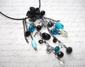 Black and blue cascade flower necklace
