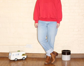 very red small turtleneck sweatshirt with one pocket