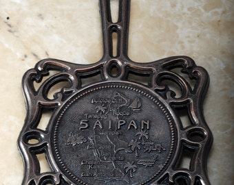 Vintage Saipan /saɪˈpæn/ is the largest island of the Northern Mariana Islands Pot Holder Cast Iron New Old Stock