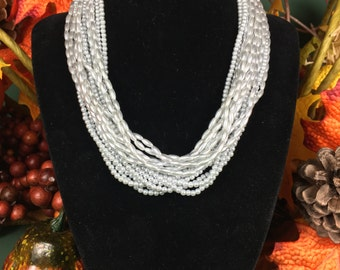 Multilevel silver tone beaded 15'' choker, with a gold tone facet with a replica Roman coin inside the facet