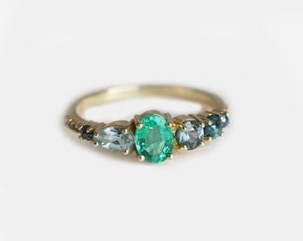emerald engagement ring emerald cluster ring cluster engagement ring oval engagement ring
