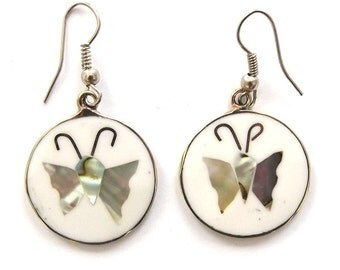 Real abalone shell dangly earrings, round white disc with butterfly design on alpaca silver. Hand made in Brazil.