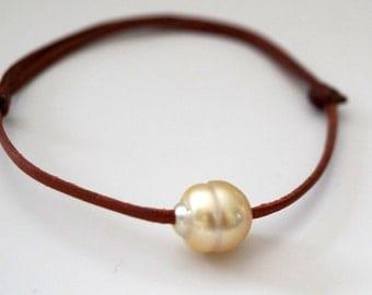 Gold australian pearl, australian leather, adaptable woman jewel