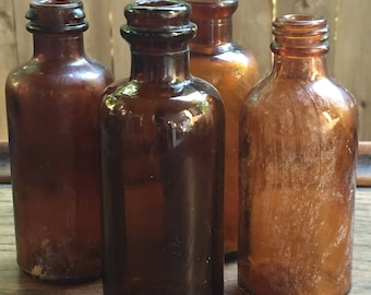 Four Vintage Brown Glass Medical Bottles
