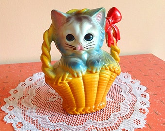 Vintage plastic bank kitty cat in basket