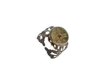 Elegant ring with real flower