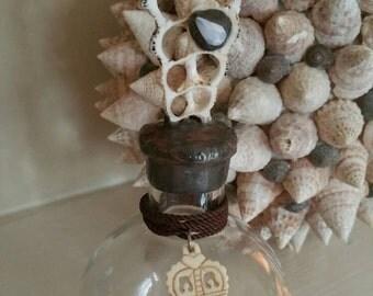 Hand soldered sea shell bottle