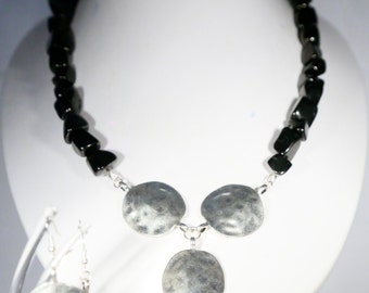 The calming Magnesite paired with hammered silver plated discs in a necklace along with matching earrings