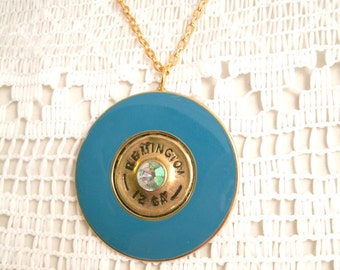 Remington 12 Guage repurposed gun shell Necklace Faceted Color Crystal center Blue Enameled vintage Gold plated base