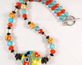 Yellow Blue and Red Orange Necklace with Lara Lutrick Lampwork Focal Bead