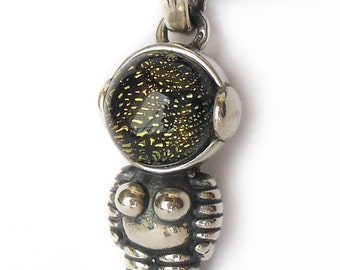 Woman Astronaut Silver pendant with dichroic glass