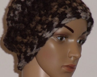 Crocheted hat with a soft yarn in different shades of grey and Brown