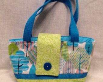 """Lunch Bag: """"Tree't' Bag"""" Washable insulated lunch bag with drawstring closure at the top."""