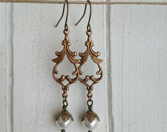 Long Dangle earrings - antique brass attached with crystal pearl.