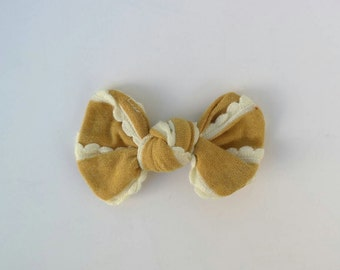 Mustard scalloped top knot bow