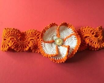 Orange hand crochet headband with large crocheted flower size 3-4 years