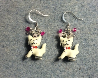 White enamel cat charm earrings adorned with tiny dangling pink and purple Chinese crystal beads.