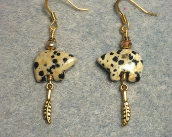 Dalmatian jasper gemstone Zuni bear fetish bead earrings adorned with tiny gold feather charms and tan crystal beads.