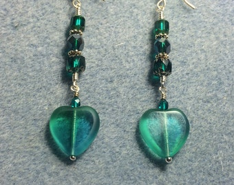 Teal Czech glass heart bead dangle earrings adorned with teal Czech glass beads.