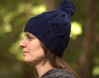 Navy knitted hat Winter pompom hat Womens cable knit hat Ski beanie Dark blue hat Chunky navy hat with pompon