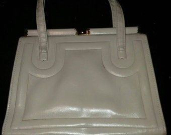 Cream vintage leather purse.