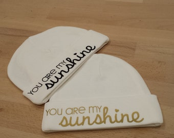 """Birth bonnet """"You are my sunshine"""" colours black and gold."""