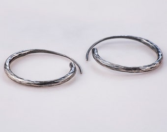 Round hoops. Silver earring. Polisher silver.
