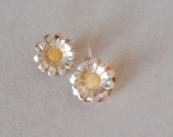 Silver and gold plated daisies