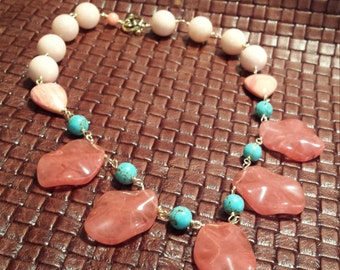 One strand necklace made with faceted rose quartz teardrops, spiny oyster, turquoise and mauve jade